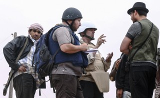 American journalist Steven Sotloff, shown here in the black helmet talking to Libyan rebels in June 2011, was reportedly killed by Islamic fighters Tuesday. Photo by Etienne de Malglaive via Getty Images
