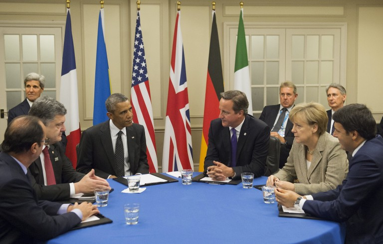 (From L-R) French President Francois Hollande, Ukrainian President Petro Poroshenko, U.S. President Barack Obama, British Prime Minister David Cameron, German Chancellor Angela Merkel and Italian Prime Minister Matteo Renzi hold a meeting on the situation in Ukraine at the Celtic Manor Resort during the 2014 NATO Summit, in Newport, Wales, on September 4. Photo by SAUL LOEB/AFP/Getty Images