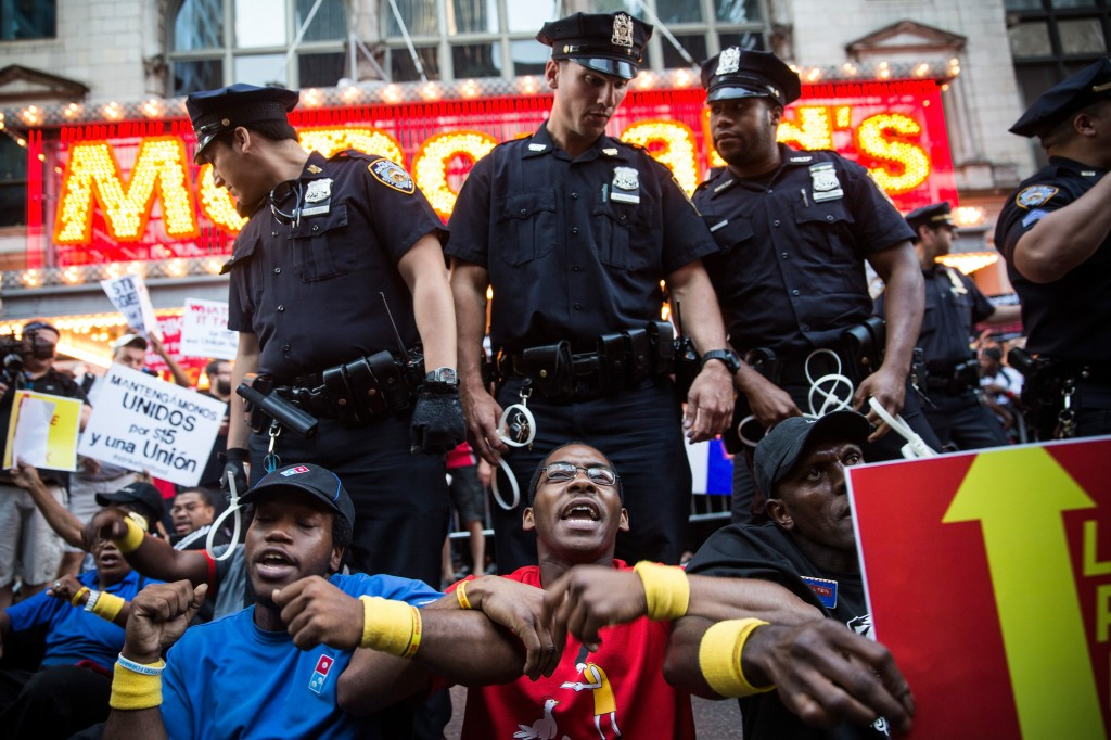 Protesters demanding higher wages and unionization for fast food workers block traffic near Times Square on Sept. 4, 2014 in New York City. Protests are planned in more than 150 cities throughout the U.S. today, as workers demand higher wages. Photo by Andrew Burton/Getty Images