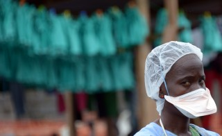 A health worker stands on September 7, 2014 at Elwa hospital in Monrovia, LIberia which is run by the non-governmental French organization Doctors without Borders. US President Barack Obama said in an interview aired on September 7 the US military would help in the fight against fast-spreading Ebola in Africa. Dominique Faget/AFP/Getty Images)