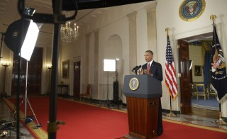 "President Obama spoke during a primetime address to the nation from the Cross Hall of the White House on Wednesday. Obama announced a broad military campaign to ""degrade and ultimately destroy"" Islamic State militants. Photo by SAUL LOEB/AFP/Getty Images"