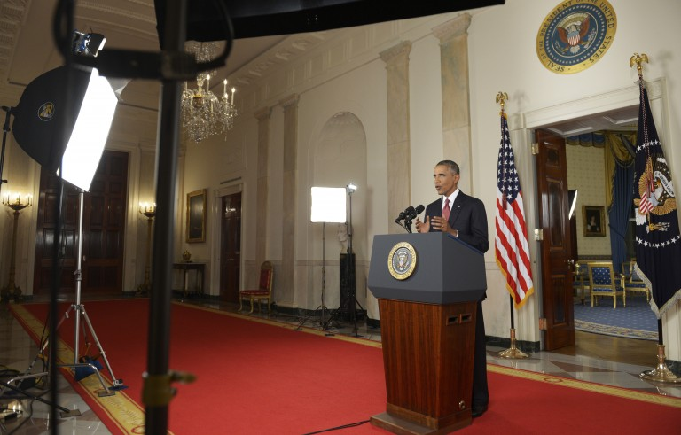 """President Obama spoke during a primetime address to the nation from the Cross Hall of the White House on Wednesday. Obama announced a broad military campaign to """"degrade and ultimately destroy"""" Islamic State militants. Photo by SAUL LOEB/AFP/Getty Images"""