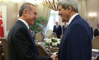 U.S. Secretary of State John Kerry, R, meets Turkey's President Recep Tayyip Erdogan, L, during Kerry's official visit at Cankaya Palace in the capital Ankara, Turkey on September 12, 2014. Photo by Kayhan Ozer/Anadolu Agency/Getty Images