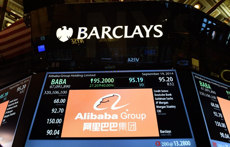A screen with Chinese online retail giant Alibaba's stock price is picrtured on the floor at the New York Stock Exchange in New York on September 19, 2014. A buying frenzy sent Alibaba shares sharply higher Friday as the Chinese online giant made its historic Wall Street trading debut. In early trades after the record public share offering, Alibaba leapt from an opening price of $68 to nearly $100 and, while it dropped back, was still up some 38 percent at $94.08 after 10 minutes. AFP PHOTO/Jewel Samad        (Photo credit should read JEWEL SAMAD/AFP/Getty Images)