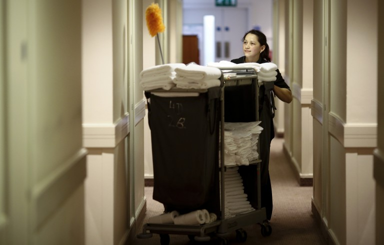 File photo of a hotel cleaning staff member by Simon Dawson/Bloomberg via Getty Images