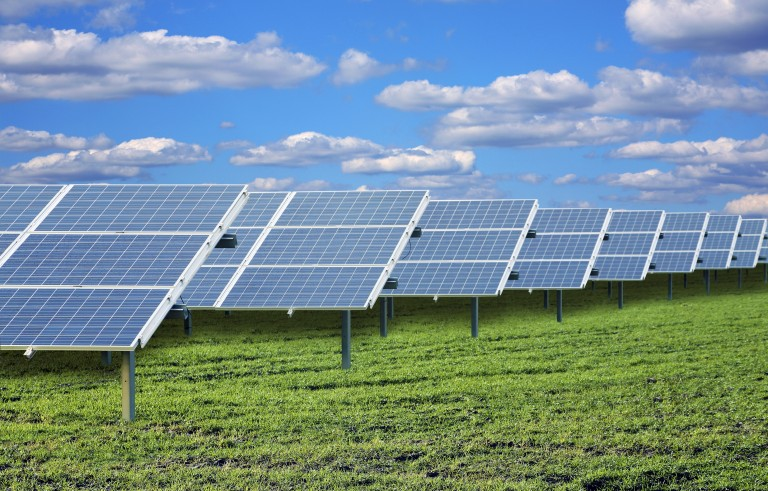 File photo of solar panels by Victor de Schwanberg/Getty Images
