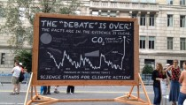 Science Stands created a large, rolling fake chalkboard illustrating the scientific evidence of global warming for the Sept. 21 People's Climate March. Credit: Carey Reed/NewsHourWeekend