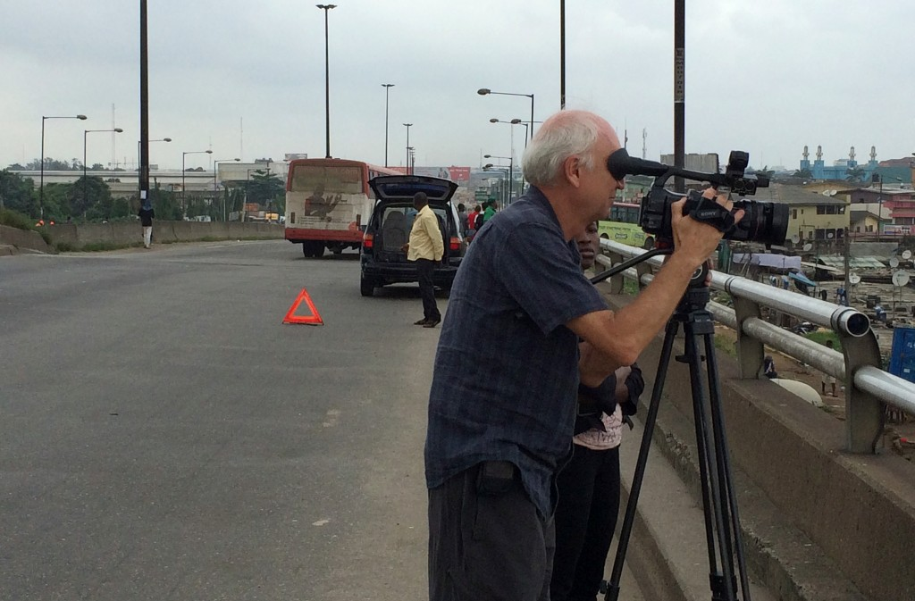 Tom Adair shooting in Lagos for the NewsHour. Photo by Fred de Sam Lazaro