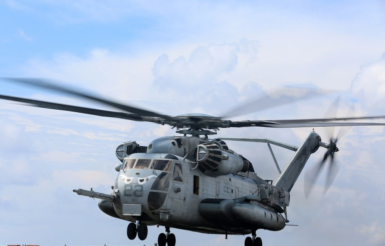 A CH-53E Super Stallion with Marine Medium Tiltrotor Squadron 163 (Reinforced), 11th Marine Expeditionary Unit, takes off from the flight deck of the USS Comstock  Aug. 25. The 11th MEU and Makin Island Amphibious Ready Group are deployed to the U.S. 7th Fleet area of operations as a sea-based, expeditionary crisis response force capable of conducting amphibious missions across the full range of military operations. (U.S. Marine Corps photo by Sgt. Melissa Wenger/Released)