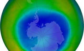 The false-color view of the monthly-averaged total ozone over the Antarctic pole. The blue and purple colors are where there is the least ozone, and the yellows and reds are where there is more ozone. Photo by NASA.