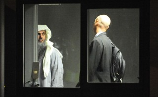 Abu Qatada, pictured here in 2013 with an escort during his deportation from Britain, was acquitted of terrorism charges Wednesday in Jordan.  Photo by UK Home Office