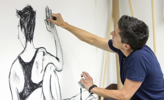 "U.S. cartoonist and author of ""Fun Home: A Family Tragicomic,"" Alison Bechdel works in her studio in central Italy, Tuesday. Bechdel is a recipient of the 2014 MacArthur Fellows Award. Photo courtesy of the John D. and Catherine T. MacArthur Foundation."