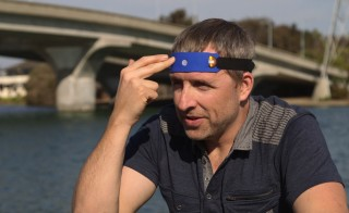 """Biohacker"" Dave Asprey demonstrates a headband that he claims electrically stimulates blood to reach the front of the brain to improve cognition. Photo by Jason Lelchuk"