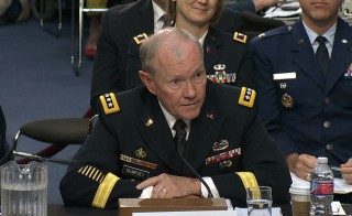 "Testifying in front of a Senate panel Tuesday, Army Gen. Martin Dempsey said he would make the recommendation to the president if the campaign failed. Defense Secretary Chuck Hagel said President Barack Obama's military campaign against the Islamic State militants will not be ""an easy or brief effort. We are at war with ISIL, as we are with al-Qaida."" Video still by PBS NewsHour"