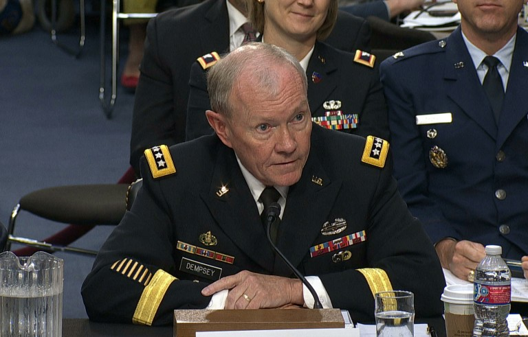 """Testifying in front of a Senate panel Tuesday, Army Gen. Martin Dempsey said he would make the recommendation to the president if the campaign failed. Defense Secretary Chuck Hagel said President Barack Obama's military campaign against the Islamic State militants will not be """"an easy or brief effort. We are at war with ISIL, as we are with al-Qaida."""" Video still by PBS NewsHour"""