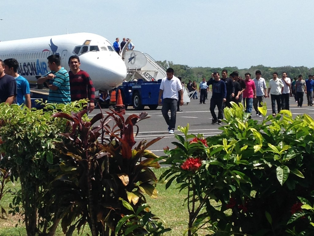 Deportees from the U.S. cross the tarmac at El Salvador's Comalapa Airport. Photo by Kate Sheehy/Fronteras Desk