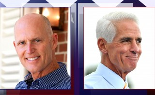 Gov. Rick Scott refused to take the stage for eight minutes during Wednesday's Florida gubernatorial debate, due to his opponent, former Gov. Charlie Crist, using an electric fan at his podium.