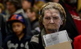 "Charlene Houchins, seen here as she was about to cast her ballot on Election Day in 2012, has been voting for more than 60 years. Dedicated voters like her make up the majority in the midterms making a ""swing"" vote unlikely. Photo by Michael S. Williamson/The Washington Post via Getty Images"