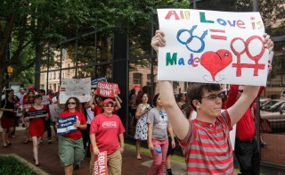 Demonstrators march in Columbia, South Carolina, on Wednesday, June 26, 2013, in celebration after the U.S. Supreme Court struck down the Defense of Marriage Act. Photo by Tim Dominick/The State/MCT via Getty Images