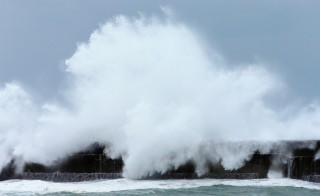 High waves triggered by typhoon Vongfong hits a pier at Haruno Fish Port on October 12, 2014 in Kochi, Japan. The typhoon struck Okinawa on Sunday, followed by the islands of Kyushu and Shikoku Monday. Photo by The Asahi Shimbun via Getty Images
