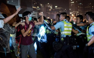 Pro-democracy protesters clash with police officers in Hong Kong on Oct. 15. Photo by Alex Ogle/AFP/Getty Images