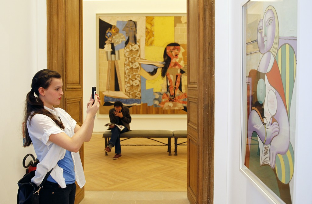 A visitor takes a picture of a Picasso painting during the press day at the Picasso Museum, on October 18, 2014 in Paris, France. Credit: Thierry Chesnot/Getty Images