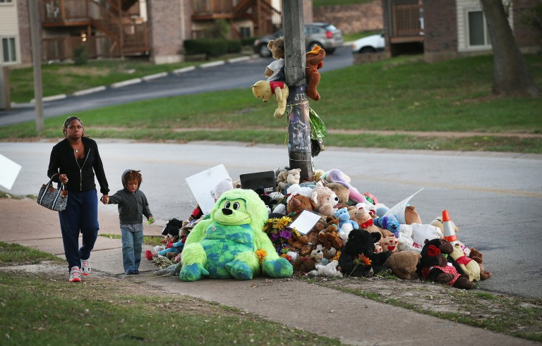 A memorial for 18-year-old Michael Brown remains on Canfield Street in Ferguson, Missouri. Brown was shot and killed on Canfield by Darren Wilson a Ferguson police officer on Aug. 9. Photo by Scott Olson/Getty Images