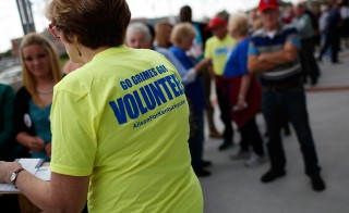 Kentucky voters line up to attend a rally with former U.S. President Bill Clinton campaigning with U.S. Senate Democratic candidate and Kentucky Secretary of State Alison Lundergan Grimes October 21, 2014 in Owensboro, Kentucky. Grimes remains locked in a tight race with Senate Minority Leader Mitch McConnell (R-KY) with midterm elections less than two weeks away. Photo by Win McNamee/Getty Images