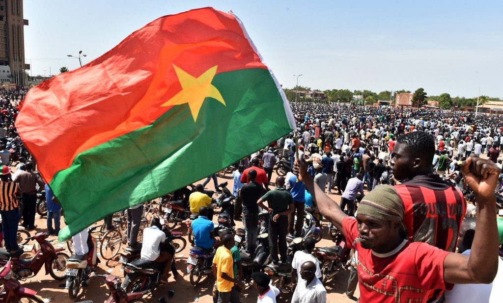 People in Burkina Faso's capital Ouagadougou celebrate after embattled President Blaise Compaore announced on Oct. 31 that he was stepping down to make way for elections following a violent uprising against his 27-year rule. Photo by Issouf Sanogo/AFP/Getty Images