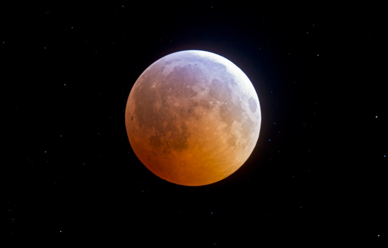 The band of turquoise across the moon, caught during a total lunar eclipse on December 21, 2010, is from sunlight filtered through the ozone layer. Image by Alan Dyer and spaceweather.com