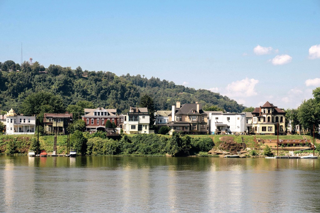 Much of Wheeling -- including Wheeling Island, as seen here from across the Ohio River -- contains rich soil that has not been used for large-scale agriculture for more than a century. Photo by Ariel Min/PBS NewsHour