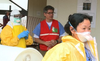 Dr. Michael Jhung, influenza expert for the CDC, trains health care workers who are planning to travel to West Africa to assist with the fight against Ebola. Photo by Emily Carpeaux