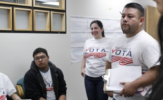Luis Valenzuela, left, Carla Castedo, center, and Ricardo Martinez, right, prepare for an evening of canvassing in heavily-Latino neighborhoods on Wednesday, Oct. 15. These workers will provide information to voters about their polling places and voting deadlines in an effort in increase voter turnout. Photo by Katie A. Kuntz/Rocky Mountain PBS I-News