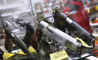 A display of 7-round .45 caliber handguns are seen at Coliseum Gun Traders Ltd. in Uniondale, New York. Photo by Shannon Stapleton/Reuters