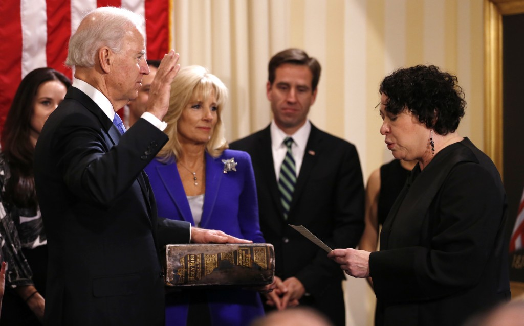 U.S. Vice President Joe Biden takes the oath of office from Supreme Court Justice Sonia Sotomayor as his wife Jill Biden holds the family bible while family members look on at the U.S. Naval Observatory in Washington January 20, 2013. Photo by Kevin Lamarque/Reuters