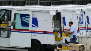 A U.S. postal worker loads up his truck with mail for delivery from the postal station in Carlsbad, California on Feb. 6, 2013. Photo by Mike Blake/Reuters