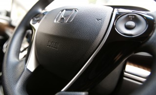 The logo of Honda Motor Co and an airbag logo are seen on a steering wheel of a car displayed at the company's showroom in Tokyo. Yuya Shino/Reuters