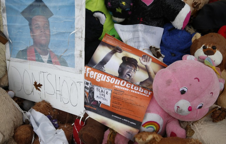 """A pamphlet for the """" Ferguson October"""" demonstrations is seen on the a makeshift memorial for Michael Brown in Ferguson, Missouri"""