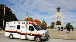 An ambulance is pictured alongside the Canadian War Memorial in Ottawa