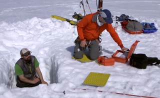 Karl Kreutz, University of Maine, and Seth Campbell, U.S. Army Corps of Engineers, dig into the Ruth Glacier in Alaska. Photo courtesy Science Nation/National Science Foundation