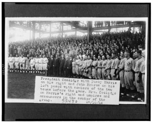 Oct. 9, 1924 -- President Coolidge with Bucky Harris on his right and John McGraw on his left, posed with members of the two teams before World Series game; Mrs. Coolidge on Harris's right and umpires and announcers in the center. Courtesy of Library of Congress.