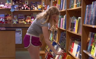 A girl picks out a book at the Scholastic store in New York City. Credit: NewsHour