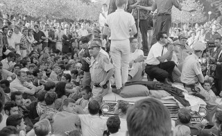Crowd surrounds the police car in Sproul Plaza holding student activist Jack Weinberg at the University of California, Berkeley on Oct. 1, 1964. Photo courtesy  U.C. Berkeley, Bancroft Library