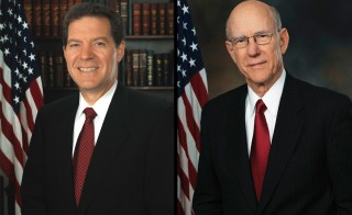 Kansas Gov. Sam Brownback (L) and Sen. Pat Roberts (R), both Republicans, may be fighting a tide of anti-incumbent sentiment in their reelection bids.
