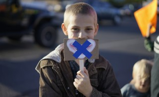 A young protester holds up a sign referring to censorship in schools in Wheat Ridge, Colorado October 3, 2014. REUTERS/Rick Wilking.