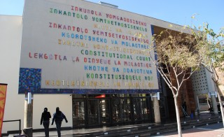 "On the entrance to the building, the words ""Constitutional Court"" is written in all eleven official languages of South Africa. Photographed by Janine Erasmus and Wilma den Hartigh"