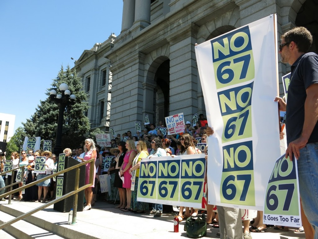 Opponents to the personhood amendment -- Amendment 67 -- rally at the state Capitol in Denver, Colo. on July 22, 2014. Photo by CPR/Megan Verlee)