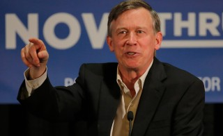 Colorado Gov. John Hickenlooper appeared at a rally for Sen. Mark Udall, D-Colo., in Aurora, Colorado on Oct. 21. Hickenlooper went on to narrowly win re-election, but Udall did not. Photo by Doug Pensinger/Getty Images