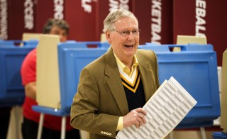 Senate Minority Leader U.S. Sen. Mitch McConnell (R-KY) holds his ballot after voting in the midterm elections at Bellarmine University November 4, 2014 in Louisville, Kentucky. McConnell is running in a tight race against opponent Kentucky Secretary of State Alison Lundergan Grimes. Photo by Aaron P. Bernstein/Getty Images