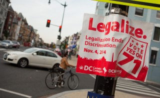 A sign promoting the DC Cannabis Campaign's initiative to legalize marijuana is displayed on a corner in the Adams Morgan neighborhood on Tuesday in Washington D.C. Photo by Allison Shelley/Getty Images
